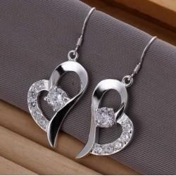 Sølv øreringe med hjerte og similisten