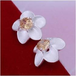Sølv øreringe med blomst og sten